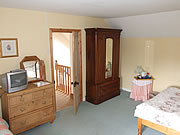 Double room featuring wardrobe and chest of drawers for ample storage